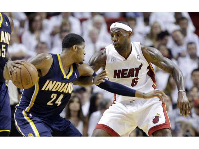 James scores 30, Heat take Game 5, 90-79