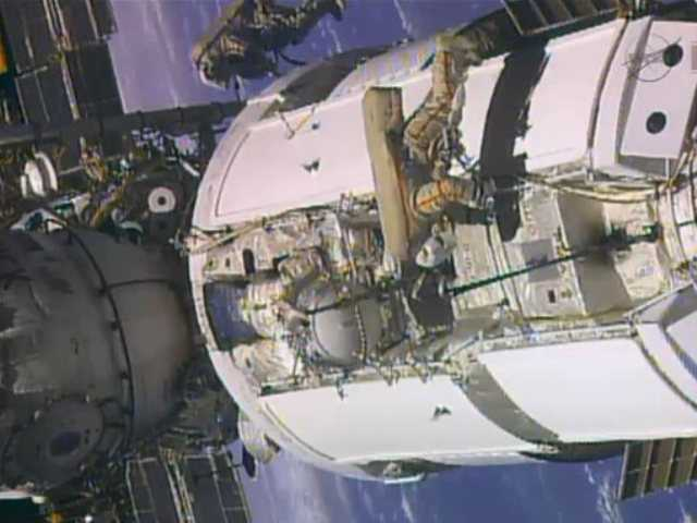 Russian astronauts take spacewalk at space station