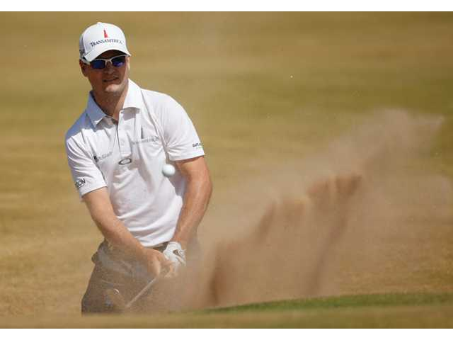 Zach Johnson handles difficult conditions to hold first round lead