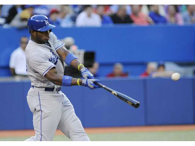 Ellis, Puig lead Dodgers past Blue Jays 8-3 in 10