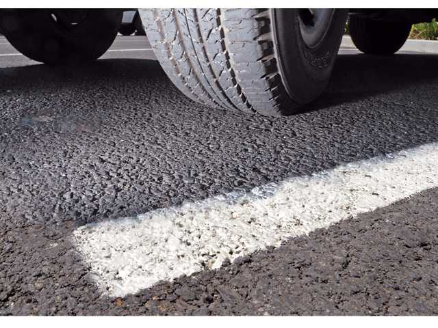 Pollution fine will fund city's pavement project