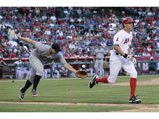 Masterson, Swisher lead Indians over Angels 3-1