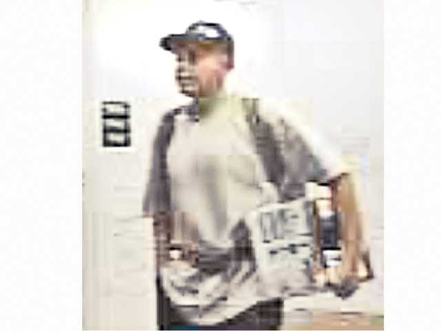 Detectives seek man for questioning in burglaries
