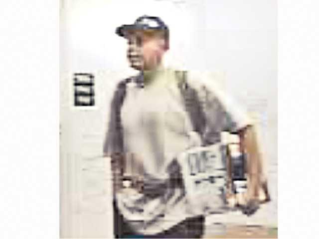 Detectives seek man for questioning in burglaries