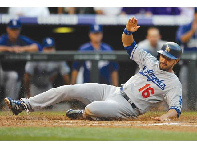 Nolasco leads Dodgers past Rockies