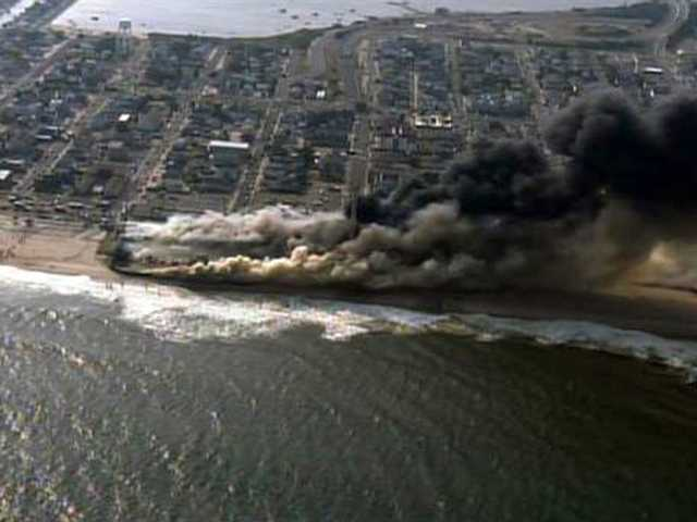 Fire rages along NJ boardwalk damaged by Sandy