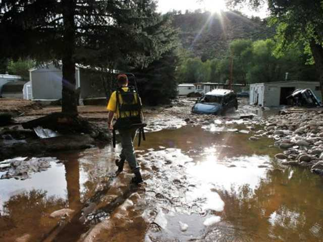 Rescues accelerate as floodwaters inundate plains