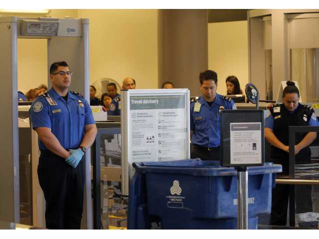 Airports hold silent tribute for slain TSA officer