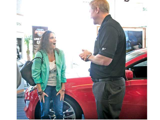 Canyon Country woman wins free car