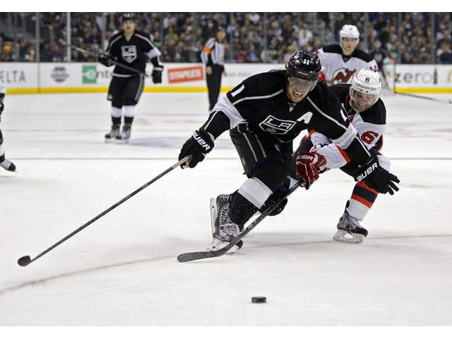 OT goal helps Devils beat Kings