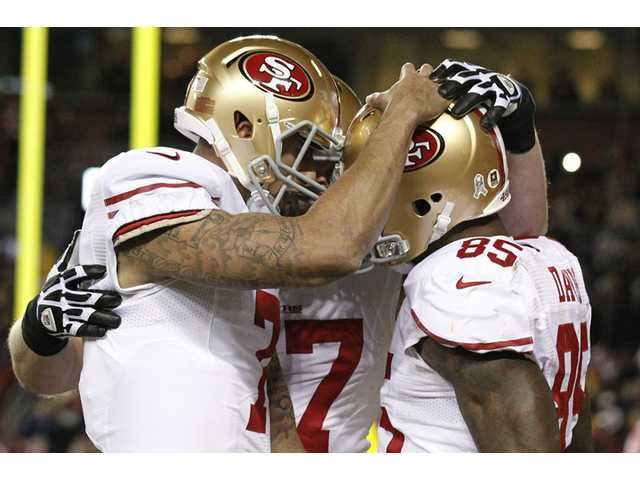 Kaepernick, 49ers dominate Redskins