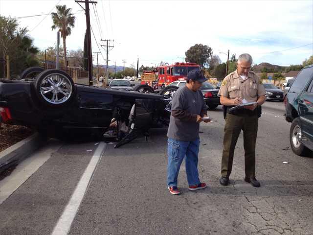 Car flips over after multi-vehicle crash