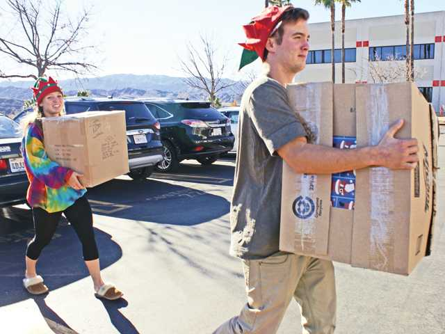 West Ranch students raise more than $5,000 to play Santa