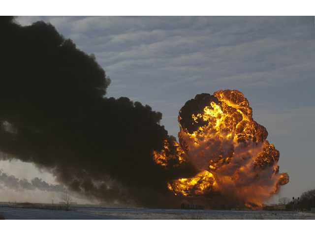 Fiery explosions in ND train derailment