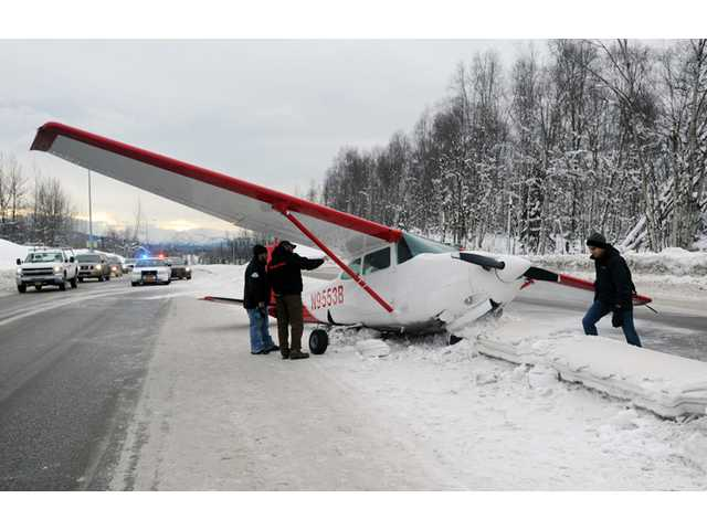 Plane lands in median of major Anchorage street