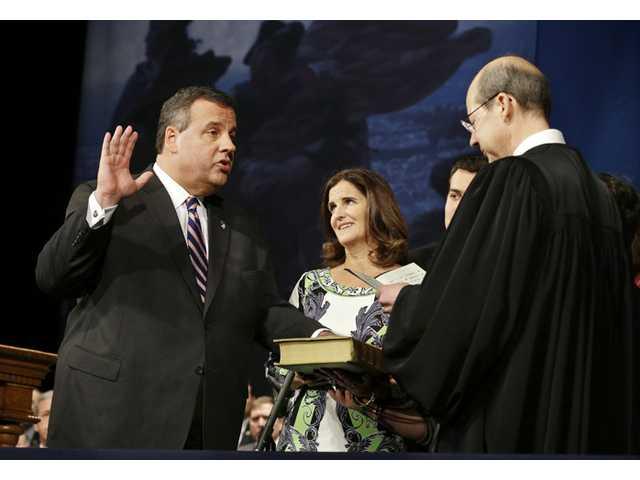 Christie takes oath amid scandal, touts mandate