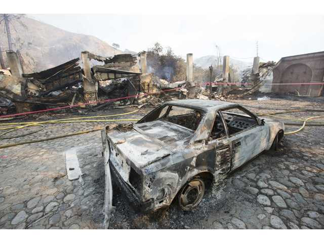 3 charged over home-destroying LA-area wildfire