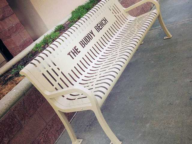 The Buddy Bench helps kids in need of a friend