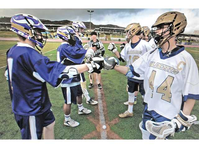 Wildcats win crosstown lacrosse bout