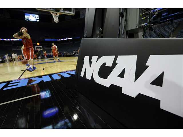 Mobile devices add allure to March Madness at work