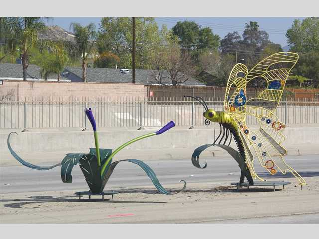 Car hits butterfly sculpture