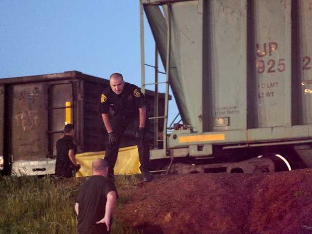 Train kills teen who pushed girlfriend from tracks