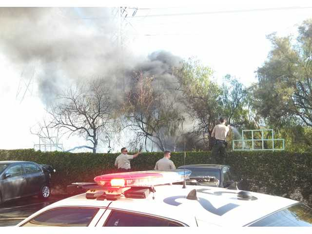Valencia brush fire burns half an acre in Santa Clara River wash