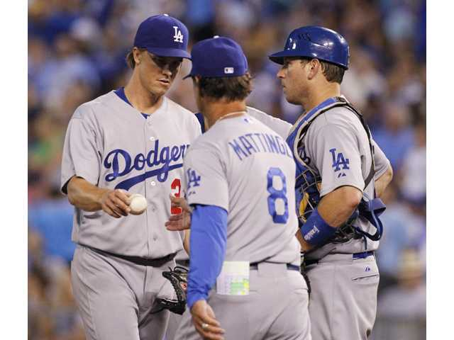 Greinke battered in Dodgers' loss to Royals
