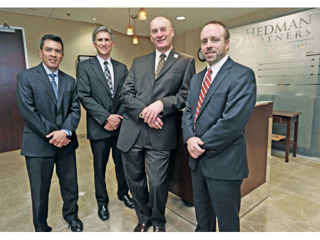 Hedman Partners marks two decades of success