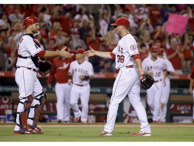 Freese's big hit lifts Angels over Astros