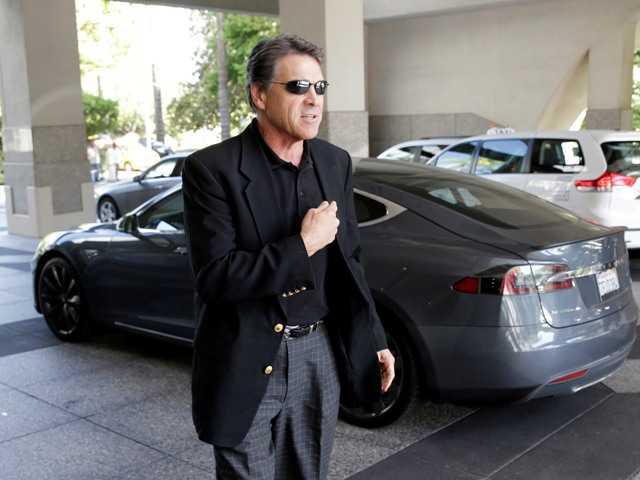 Brown signs tax bill that will benefit Tesla plant