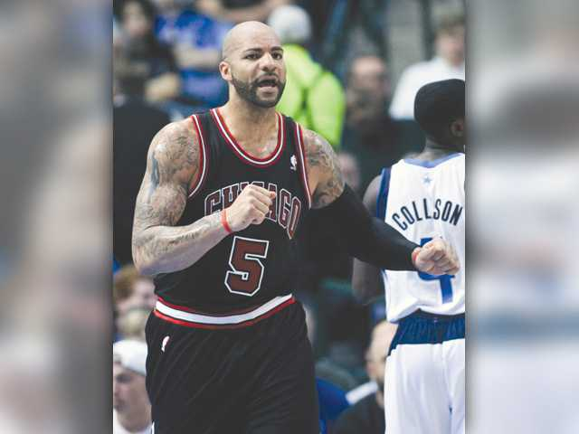 Lakers make winning bid for Boozer
