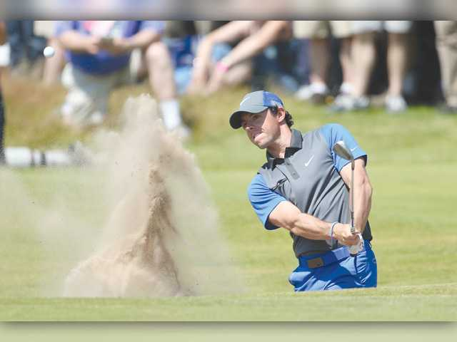 McIlroy, Woods deliver at British Open