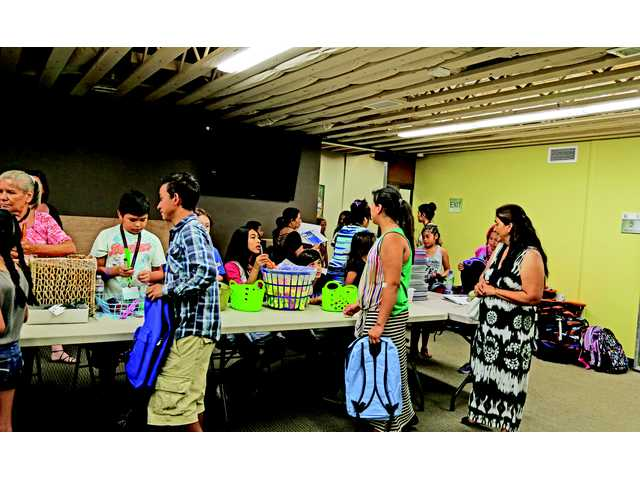 Community event to give backpacks