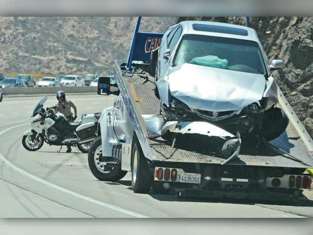 UPDATE: Two injured in Highway 14 crash