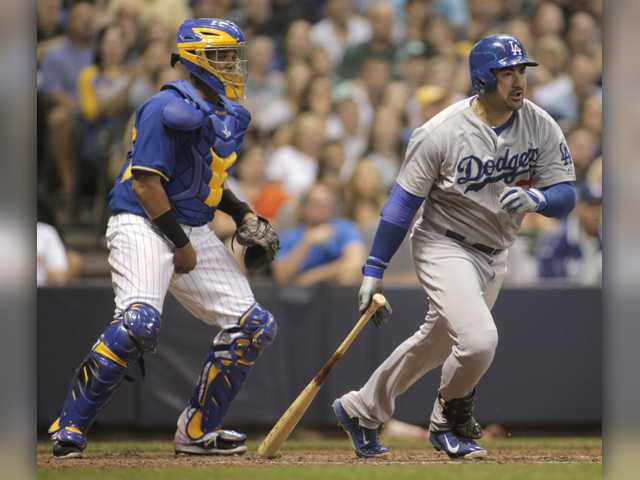 Weeks leads Brewers over Dodgers