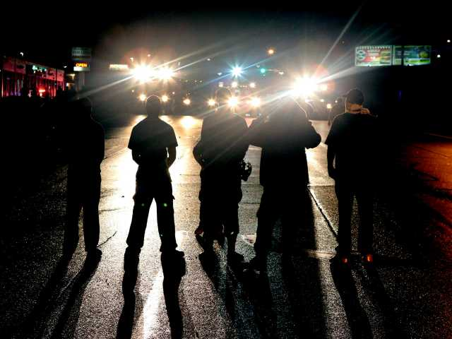 Police, protesters clash again in Ferguson