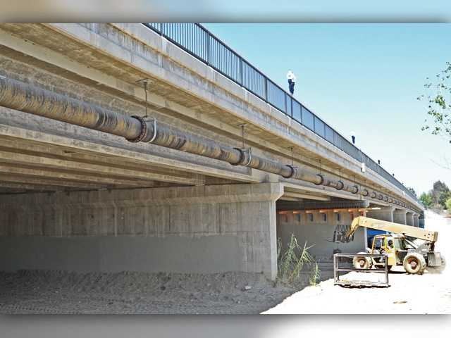 Work continuing on McBean Bridge widening project