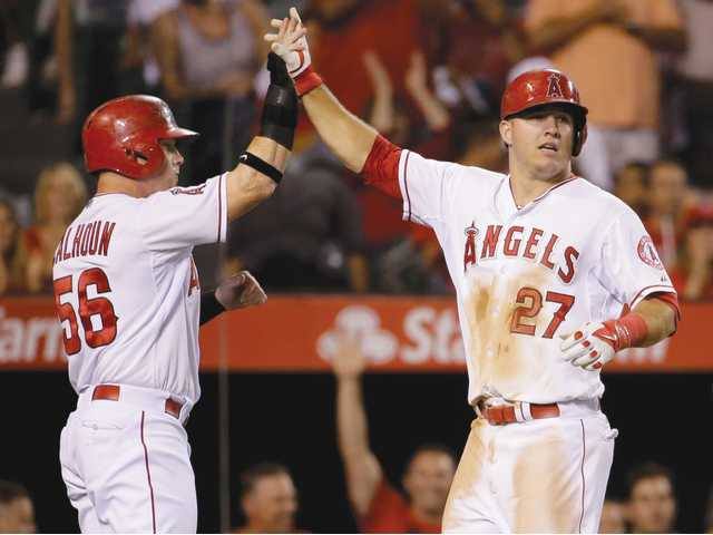 Trout, Shoemaker lead Angels' rout of Miami