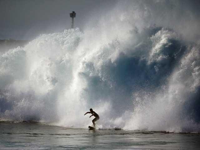 Cowabunga! Storm sends big waves to California
