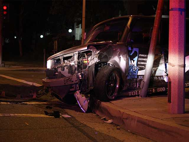 Hit-and-run takes out car, light pole