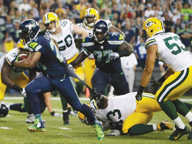 Seahawks dominate Green Bay to begin 2014