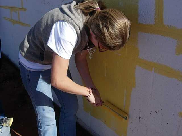 Missionary group paints preschool