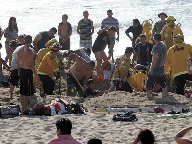 Man dies after beach hole collapses