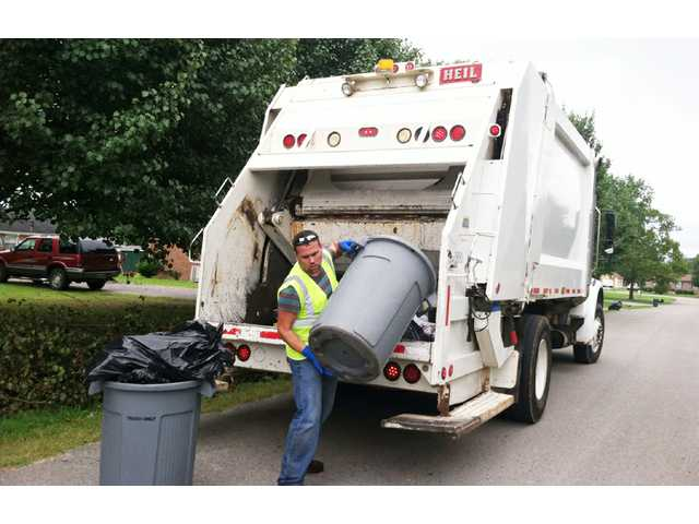 Alderman mans trash truck