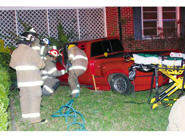 Woman injured in collision with house