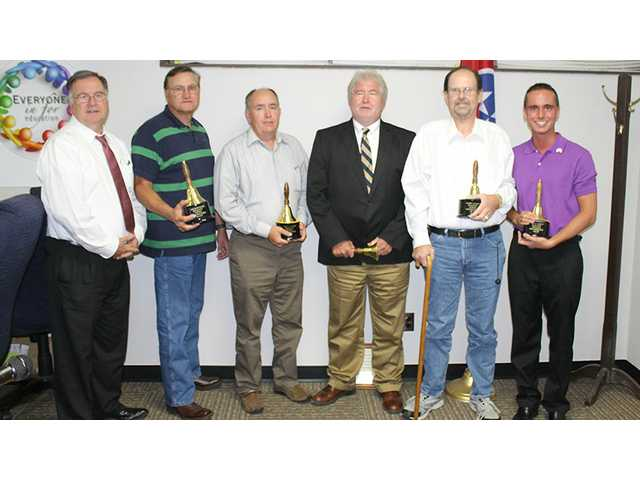 Outgoing school board members honored