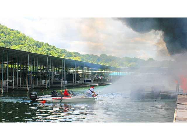 Fire destroys houseboat