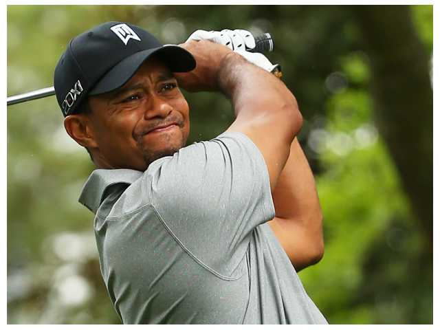 Woods says he's ahead of schedule and without pain