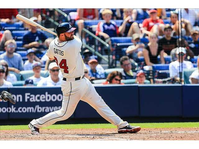 Santana, Gattis lead Braves to 2-0 win over Padres
